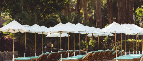Relax on a sun lounger at the Gran Canaria hotel with pool