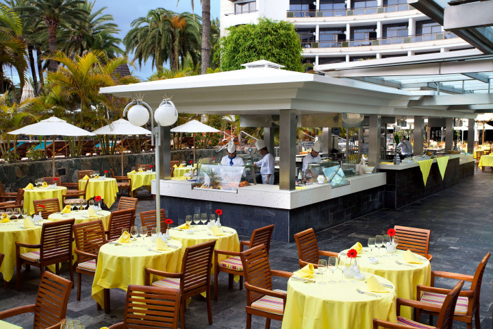 Dine al fresco on the outdoor terrace of the Seaside Palm Beach Main Restaurant